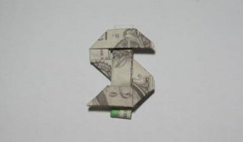 знак доллара из купюры